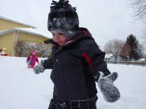 Little kid in a snow suit